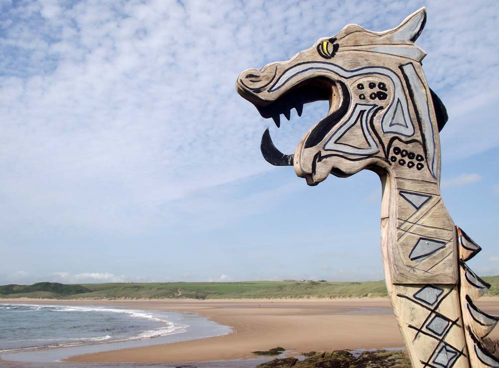 The dragon's head looks over the dunes at Cruden Bay.