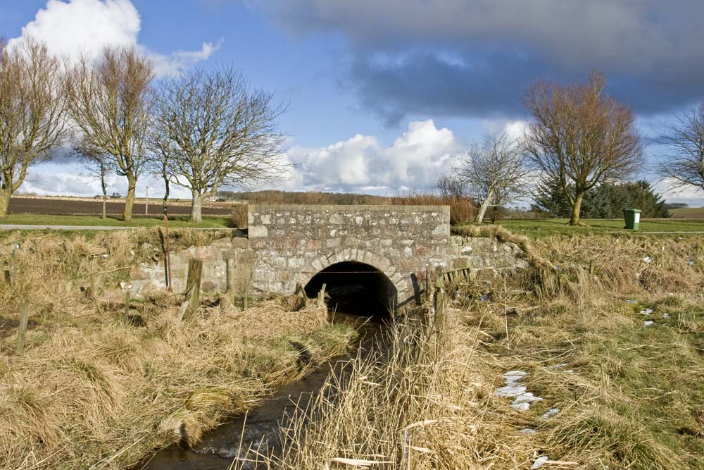 The lay-by now crosses the old bridge near Hawkhillock.  This once carried the main A952 road to Minlaw