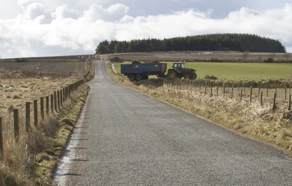 Tractor crosses the little bridge on the road to Aulton of Auquharney