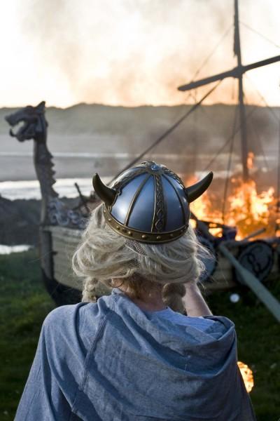 "A ""Viking"" watches the lon gship burn."