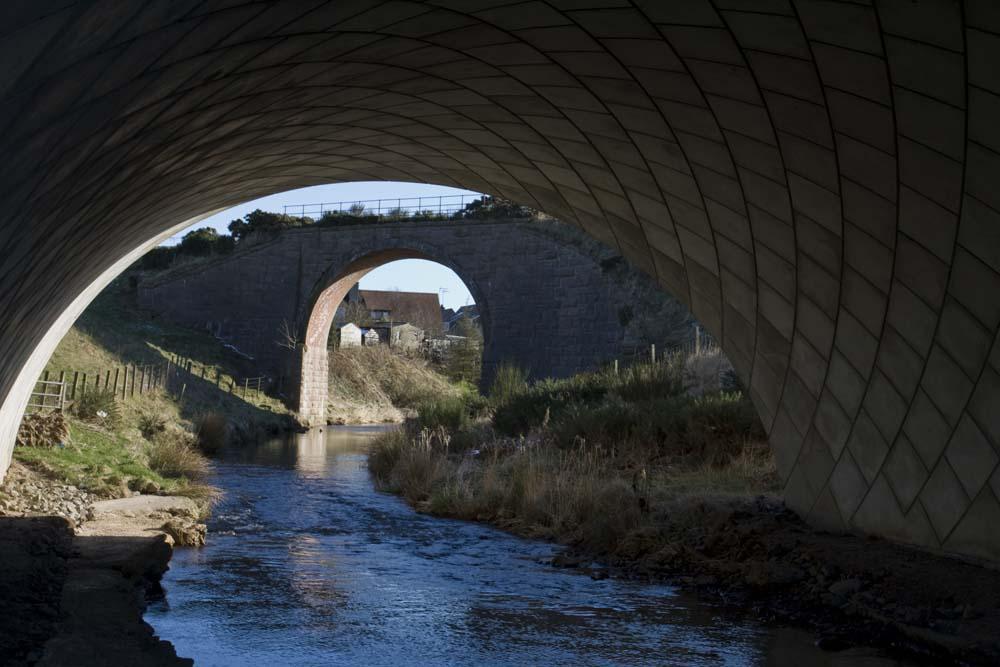 The railway bridge through the new bridge on the A90 near Midmill