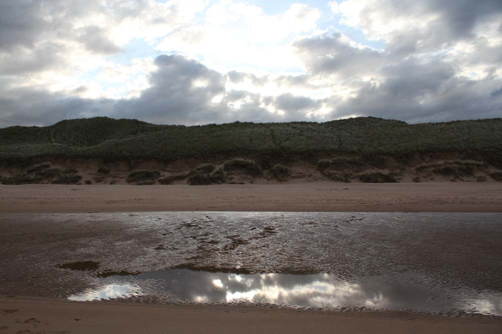 The sun goes down over the dunes at  Cruden Bay beach.   Not quite a sunset because of the clouds.