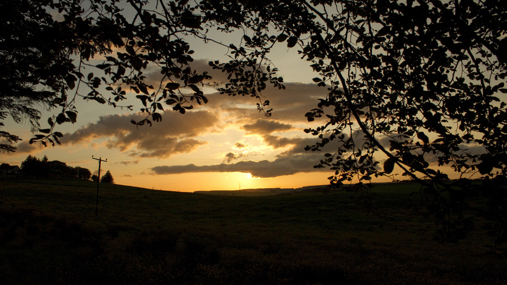 The sun sets over the Moss of Cruden.  Taken from the path behind the Manse in Hatton.
