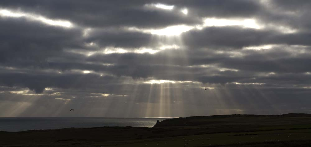 Sun breaks through the clouds.  Looking over the Longhaven Cliffs, November 2013