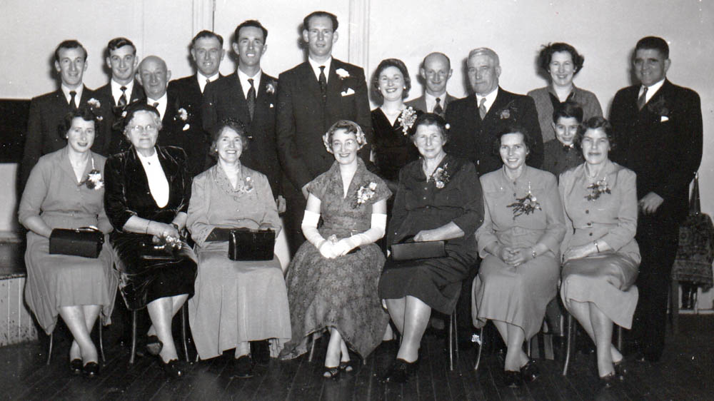 Irene and Sandy's Wedding. Pop Corbett is 3d left in the back row. Little Fred is forming a middle row on his own on the right.